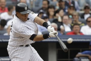 Melky's bat bends as he sends Wilson's change into the left field box seats (AP Photo/Frank Franklin II)