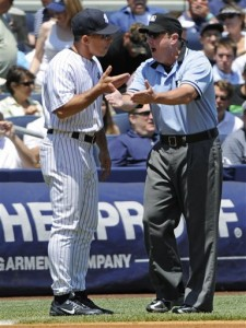 Girardi argues with third-base umpire Marty Foster (AP Photo/Bill Kostroun)