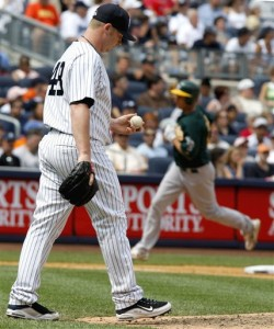 Part of Joe Girardi's plan: Phil Coke vultures the win from Sergio Mitre in the sixth thanks to a two-run Mark Ellis home run. (AP Photo/Kathy Willens)