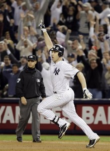 Mark Teixeira celebrates his game-winning home run as he rounds first (AP Photo/Julie Jacobson)