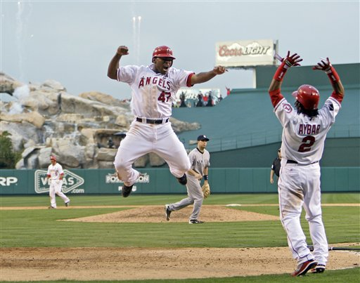 Howie Kendrick scores the winning run in the bottom of the 11th inning of Game Three of the ALCS (AP Photo/Mark J. Terrill)