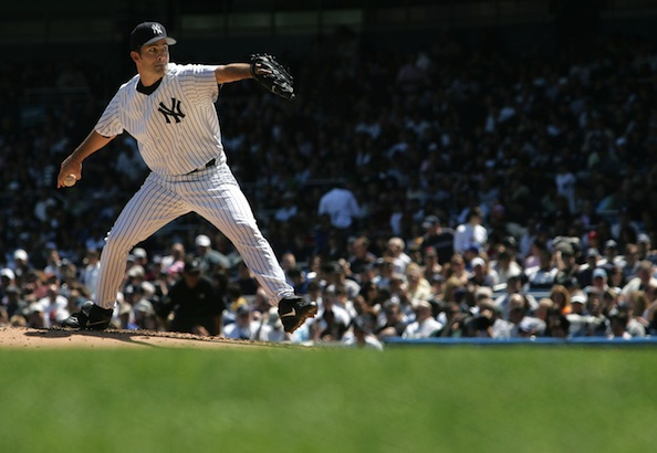 Yankees pitcher  Mussina pitches against Toronto in New York