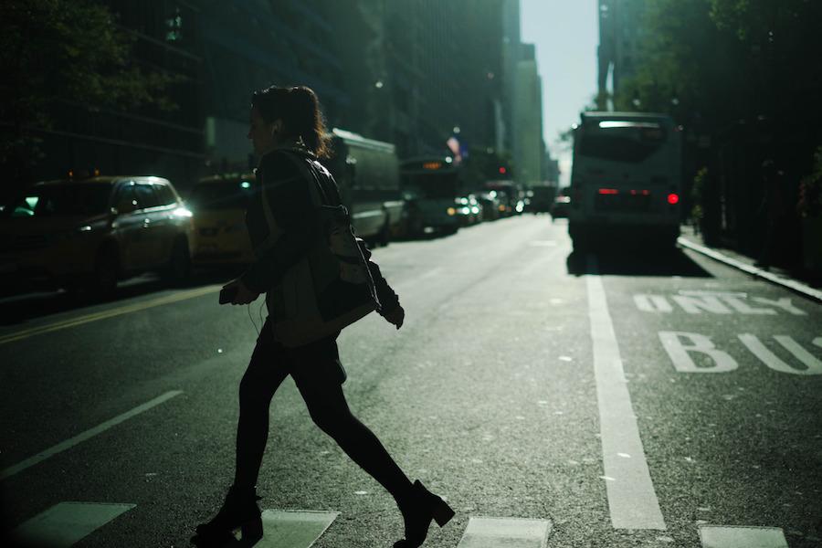girl-crossing-street-bags