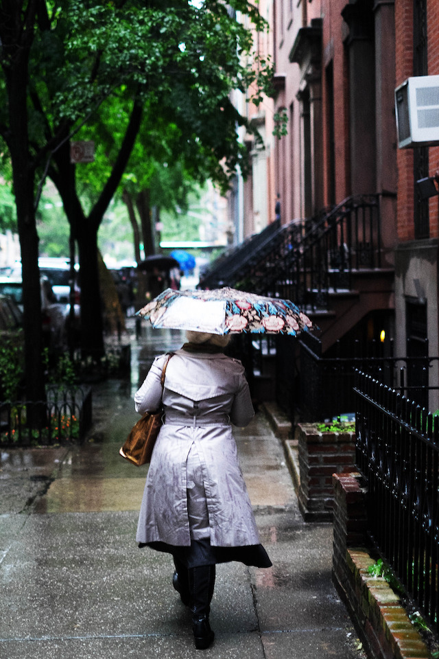 woman with an umbrella walking down the street