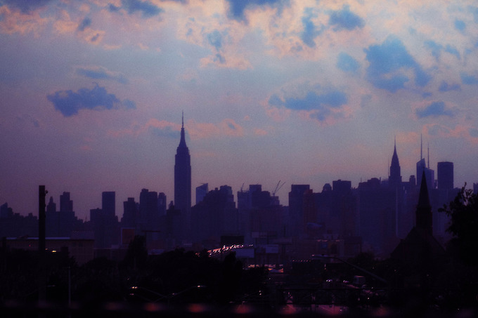 bags blue sky manhattan skyline